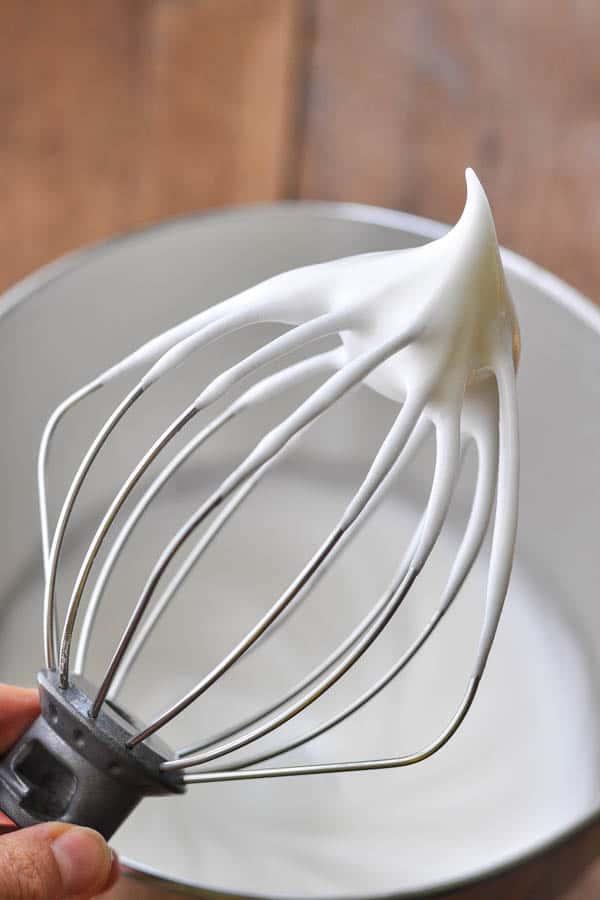 Stiff egg whites for meringue on a whisk