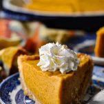 Close up front shot of a slice of No Bake Pumpkin Chiffon Pie
