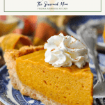 Close side shot of a slice of pumpkin chiffon pie on a blue and white plate with text title box at the top