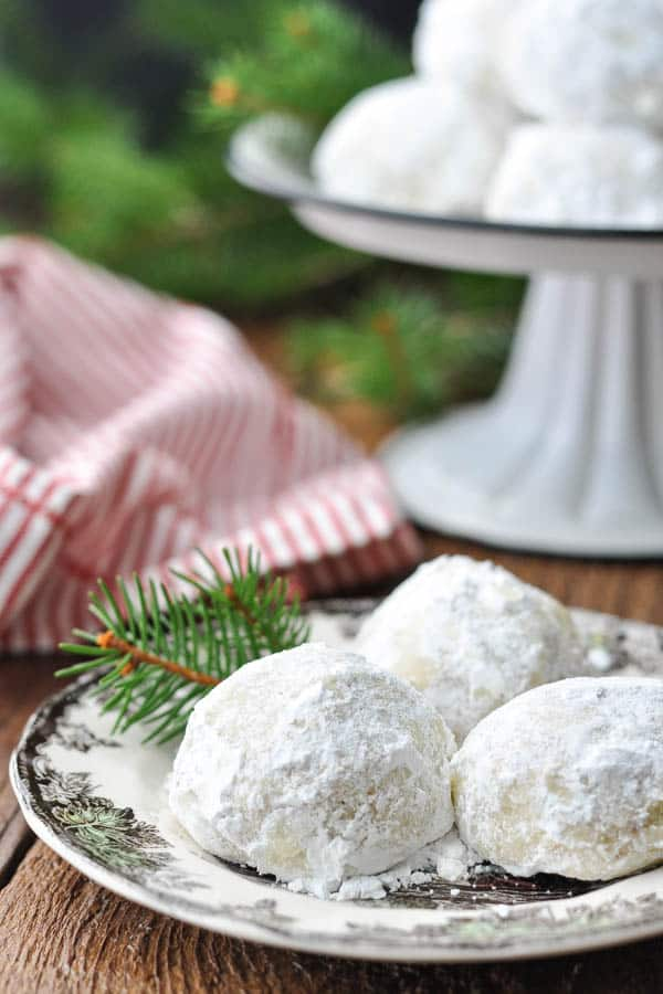 Close up side shot of a small plate of Russian Tea Cake cookies