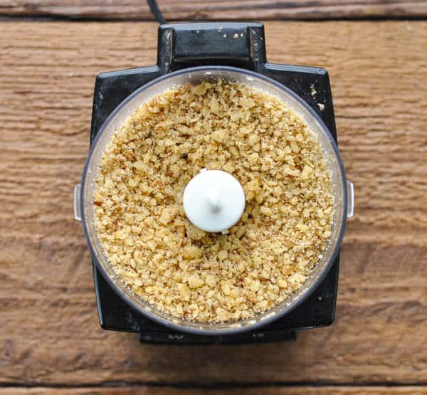 Finely chopped walnuts in a mini food processor