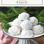 Front shot of Snowball Cookies on a platter with a text title box at the top