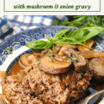 Side shot of easy salisbury steak recipe on a plate with text title box at the top