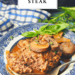 Homemade Salisbury Steak on a plate with a text title box at the top