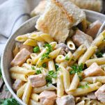 Penne pasta tossed in salmon cream sauce with a side of French baguette