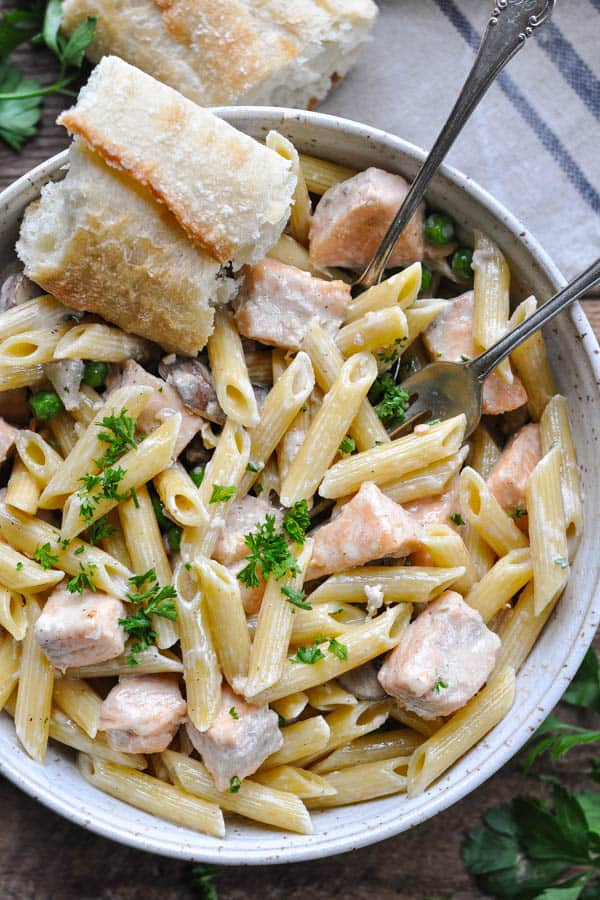 Overhead image of a bowl of fresh salmon pasta recipe