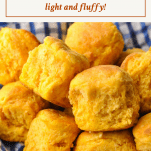 Front shot of a basket of sweet potato biscuits with a text title box at the top