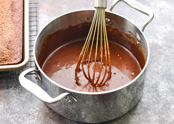 Whisking Texas Sheet Cake frosting in a pot