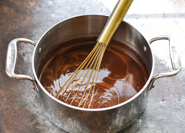 Boiling chocolate mixture for Texas Sheet Cake
