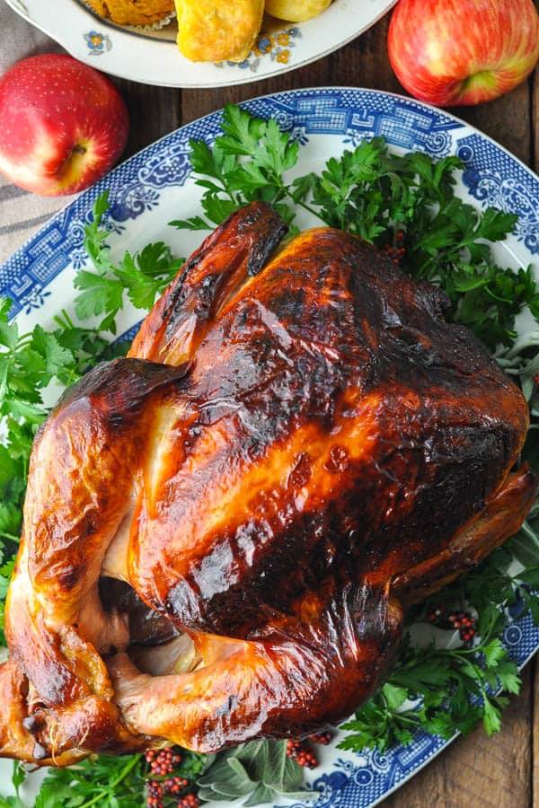 Overhead image of brined and roasted turkey on a holiday table