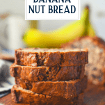 Stacked slices of banana nut bread on a board with text title box at the top