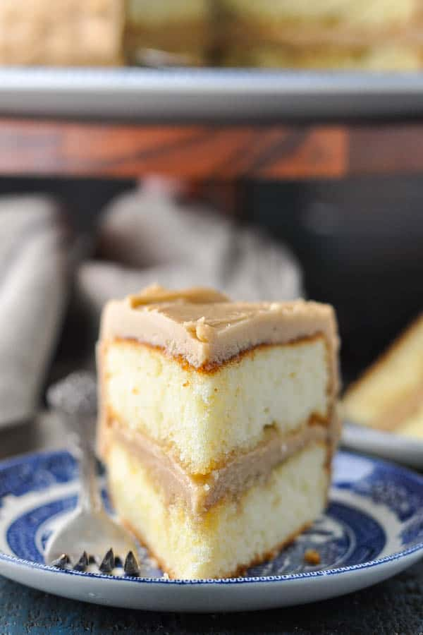 Close up front shot of a slice of caramel layer cake