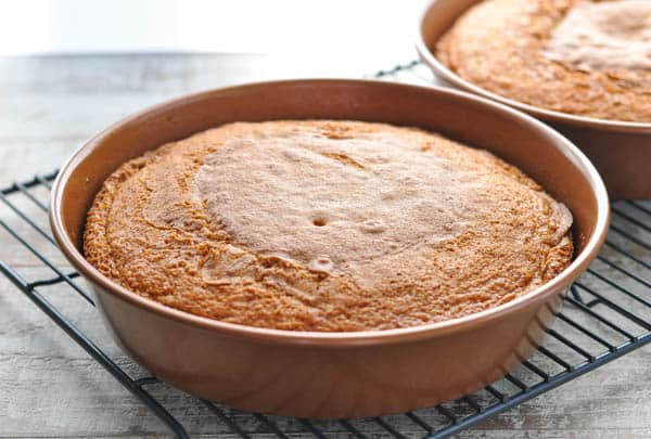 Vanilla cakes in round cake pans cooling