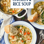 Overhead shot of two bowls of homemade chicken and rice soup on a table with text title overlay