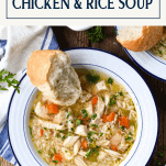 Bowl of homemade chicken and rice soup with text title box at top