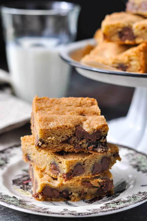 A stack of the best chocolate chip cookie bar recipe cut into squares and served on a plate