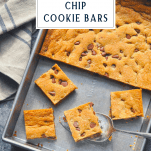 Overhead image of chocolate chip cookie bars in a pan with text title box at the top