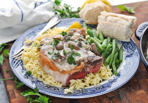 Horizontal shot of cream of mushroom pork chops on a plate