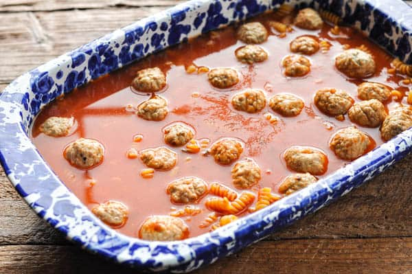 Process shot showing how to make dump and bake meatball casserole