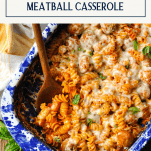 Overhead shot of meatball casserole with text title box at top