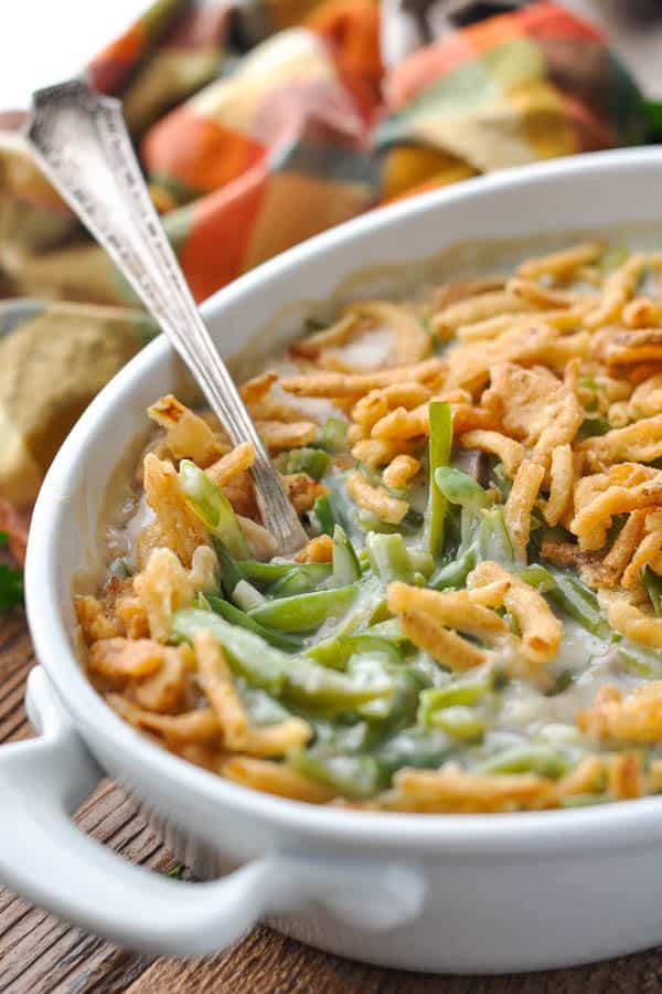 Close up front shot of a white dish full of easy green bean casserole