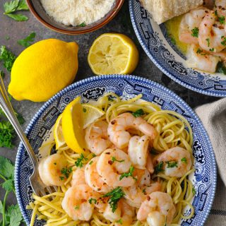 Overhead shot of shrimp scampi with pasta in a blue and white bowl