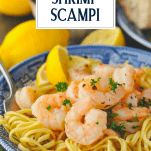 Side shot of a bowl of shrimp scampi with pasta and a title box at the top