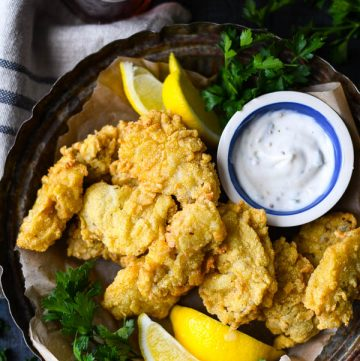 Close overhead image of cornmeal crusted fried oysters on a serving tray