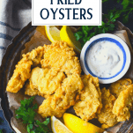 Overhead image of a plate of fried oysters with title overlay