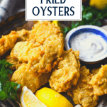 Close up shot of deep fried oyster recipe with text title box at top