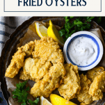Overhead shot of deep fried oysters with text overlay title