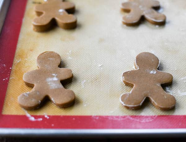 Gingerbread man cookie dough on a baking sheet