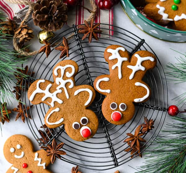 Overhead image showing how to make reindeer cookies out of gingerbread man cookie cutter
