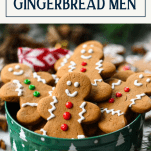Front shot of gingerbread man cookies in a tin with text title box at the top