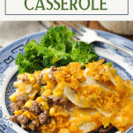 Front shot of a plate of Hamburger Potato Casserole with text title box at top