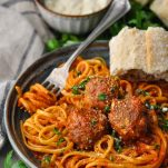 Homemade meatballs served in a bowl with spaghetti and sauce