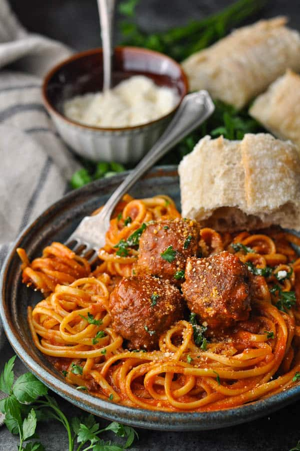 Front shot of a bowl of spaghetti and meatballs