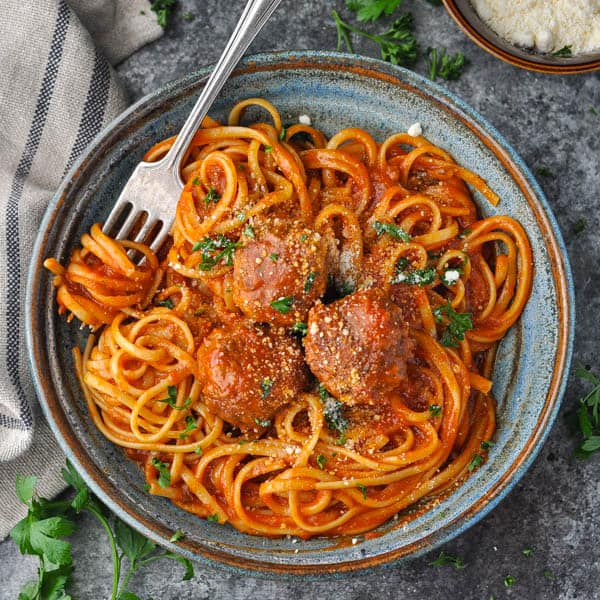 Square overhead shot of a bowl of homemade meatballs with spaghetti