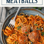 Text title box over a bowl of homemade meatballs and spaghetti