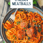 Overhead shot of Italian meatballs with spaghetti and text title overlay at the top