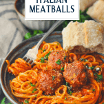 Front shot of a bowl of pasta with homemade meatballs and a title at the top