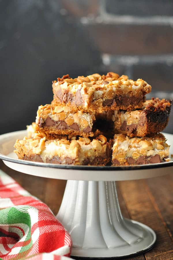 Close up side shot of Hello Dolly Bars on a white serving tray