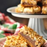 Eagle brand magic cookie bars served on a Christmas plate