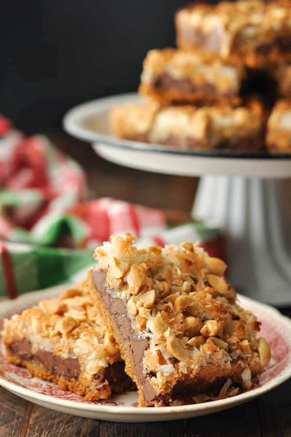Close up side shot of seven layer bars on a red and white plate