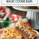 Side shot of magic cookie bars on a red and white plate with text title box at the top