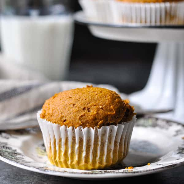 Square image of a pumpkin muffin on a plate