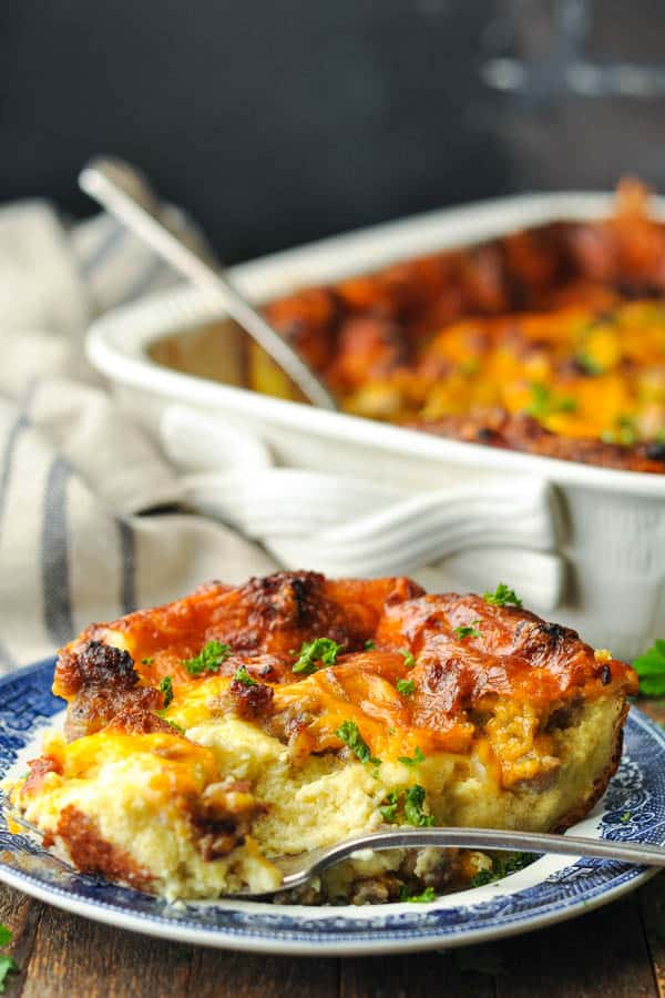 Slice of sausage breakfast casserole on a blue and white plate