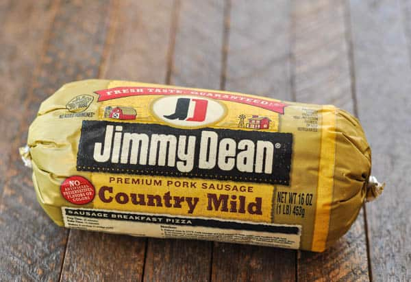 Roll of Jimmy Dean breakfast sausage on a wooden table