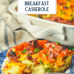 Front shot of sausage breakfast casserole on a plate with text title box at the top