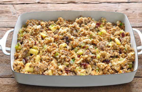 Sausage stuffing in a white dish before baking